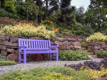 Garden bench. On a traditional flagstone patio in summer - Gramado - Rio Grande do Sul - Brazil Stock Photos