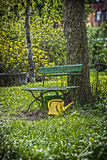 Garden bench with yellow ewer Royalty Free Stock Image