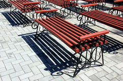 Garden benches. Group of identical garden shops Stock Photography