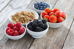 Garden berries and muesli on wooden background, horizontal Royalty Free Stock Photography