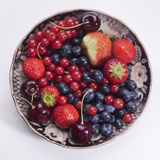 Garden berries. Some berries in an antique plate stock photography
