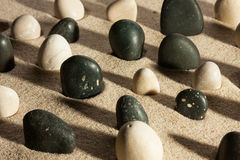 Garden of black and white stones, sticking out of the sand in th Royalty Free Stock Photography