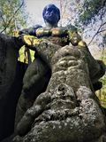 Garden of Bomarzo, Sacred Grove, Park of the Monsters, Hercules and Cacus. Garden of Bomarzo, Sacred Grove, Park of the Monsters, Manieristic monumental complex royalty free stock image