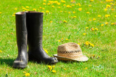 Garden boots and straw hat Royalty Free Stock Image