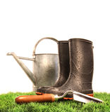 Garden boots with tool and watering can Stock Image