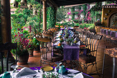 Garden Breakfast Setup Restaurant. A hotel Restaurant is ready for breakfast surrounded by flowers and gardens Stock Photo