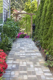 Garden Brick Paver Path with Arbor Stock Photo