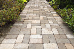 Garden Brick Paver Path Walkway. Garden Brick Pavers Path Walkway with Beasket Weave Pattern Royalty Free Stock Photography