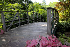Garden Bridge. A quaint bridge over a creek in the botanical gardens stock photos