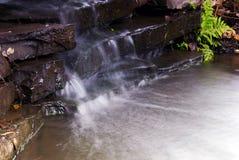 Garden Brook. A small water fall in a public park Stock Photos