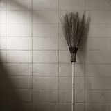 Garden broom on concrete wall background Stock Image