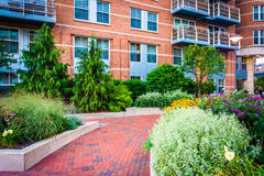 Garden and building along a walkway at Battery Wharf in Boston, Royalty Free Stock Photo