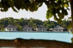 Garden bungalows in hotel on Maldives. Villas on Indian ocean at luxury spa resort. Stock Photography