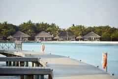 Garden bungalows in hotel on Maldives. Villas on Indian ocean at luxury spa resort. Garden bungalows in hotel on Maldives. Villas on Indian ocean at spa resort Royalty Free Stock Images