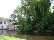 Garden at the canal. Idyllic spot at the waterfront Stock Photo