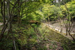 Garden canal in temple complex of Sanzen-in. Path along garden canal in Sanzen-in Temple complex in Ohara. Kyoto, Japan Stock Photos