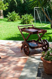 Garden cart and swimming pool Stock Image