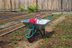 Garden cart and watering can royalty free stock image