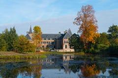Garden and castle of Twickel in autumn, Delden. Botanic garden, pond and castle of Twickel in colourful autumn, Delden, the Netherlands royalty free stock photography