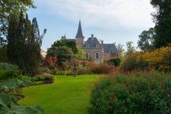Garden and castle of Twickel in autumn, Delden. Botanic garden, pond and castle of Twickel in colourful autumn, Delden, the Netherlands stock photography