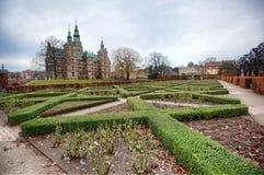 Garden and castle. Well trimmed shrubs outside the Rosenborg Castle Stock Photos