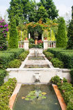 Garden With Center Fountain. Garden with a fountain spraying in the center stock photo