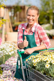 Garden center smiling woman flowers thumb up Stock Photo