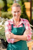 Garden center smiling woman worker wear apron Stock Images