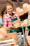 Garden center woman putting clay pots cart Royalty Free Stock Photography