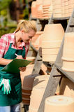 Garden center woman write notes clay pots Stock Photography