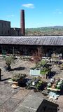 Garden Centre in Brierfield Nelson Lancashire. A new use for an old cotton mill as a retail outlet and a garden Centre with the moors of East Lancashire in the stock images