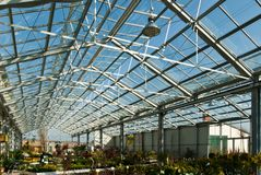 garden centre with a glass roof under a blue sky royalty free stock photo
