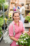 Garden centre woman hold white potted hibiscus Royalty Free Stock Images