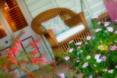 Garden chair. A beautiful spot for an afternoon drink in a garden at the back of a luxurious home at the coastal seaside village of Emu Park, on the Capricorn Royalty Free Stock Photo