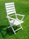 Garden chair. On grass Royalty Free Stock Photography