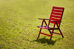 Garden chair on grass Stock Image