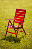 Garden chair on grass Stock Images