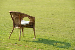 Garden chair on grass Royalty Free Stock Images