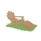 Garden chair in a grass. Wooden garden chair with ottoman in the grass Royalty Free Stock Photo