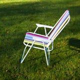 Garden chair on green grass background Stock Photo