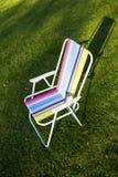 Garden chair on green grass background Stock Photos