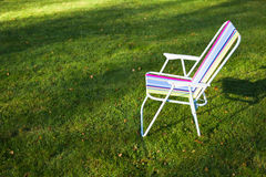 Garden chair on green grass background Royalty Free Stock Photography