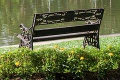 Garden chair on green grass Stock Images