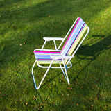 Garden chair on green lawn background Stock Photo