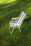 Garden chair on green lawn background Royalty Free Stock Images