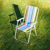 Garden chair on green lawn background Royalty Free Stock Photography