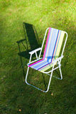 Garden chair on lawn background Stock Image