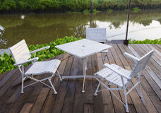 Garden chair and table with riverside Royalty Free Stock Photography