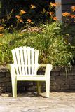 Garden Chair and Tiger Lilies Stock Images