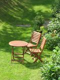 Garden chairs. Wooden chairs in the garden Royalty Free Stock Images